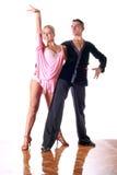 Dancers in ballroom Stock Images