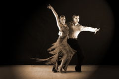 Dancers in ballroom against black background Royalty Free Stock Images