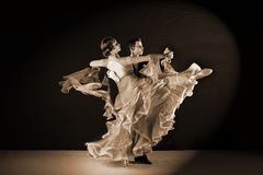 Dancers in ballroom against black background Stock Image