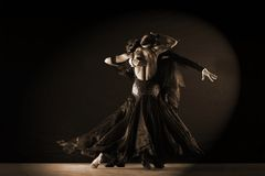 Dancers in ballroom against on black background Stock Photo