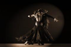 Dancers in ballroom against on black background. Latino dancers in ballroom against on black background Stock Photo