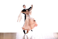 Dancers in ballroom against white background Stock Image