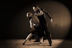 Dancers in ballroom  on black background Stock Photos