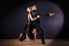 Dancers in ballroom  on black background. The dancers in ballroom  on black background Stock Photography