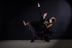 Dancers in ballroom at black background Stock Photo