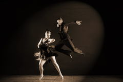 Dancers in ballroom  on black background Stock Image