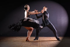 Dancers in ballroom  on black background Stock Images