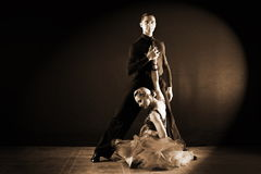 Dancers in ballroom  on black background Royalty Free Stock Photo