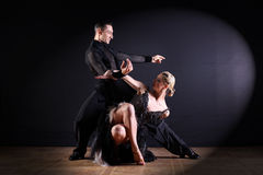 Dancers in ballroom  on black background Royalty Free Stock Images