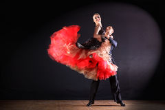Dancers in ballroom  on black background Royalty Free Stock Photography