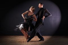 Dancers in ballroom  on black background. The dancers in ballroom  on black background Royalty Free Stock Photos