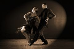Dancers in ballroom  on black background. The dancers in ballroom  on black background Stock Image