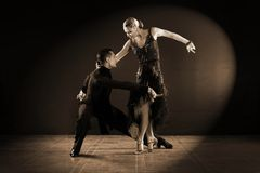 Dancers in ballroom  on black background. The dancers in ballroom  on black background Stock Photo