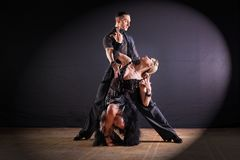 Dancers in ballroom  on black background. The dancers in ballroom  on black background Royalty Free Stock Image