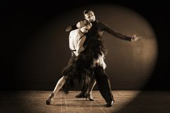 Dancers in ballroom  on black background. The dancers in ballroom  on black background Royalty Free Stock Images