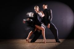 Dancers in ballroom  on black background. The dancers in ballroom  on black background Stock Images