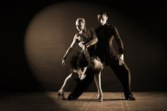 Dancers in ballroom  on black background. The dancers in ballroom  on black background Royalty Free Stock Photo