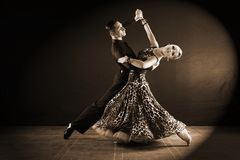 Dancers in ballroom  on black background. The dancers in ballroom  on black background Royalty Free Stock Photography
