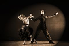 Dancers in ballroom isolated on black background. The dancers in ballroom isolated on black background Stock Images