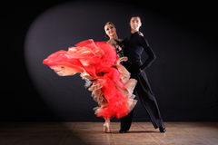 Dancers in ballroom. Isolated on black background stock images