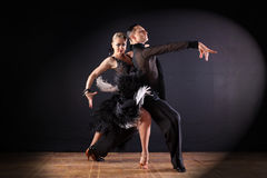Dancers in ballroom isolated on black Stock Photos