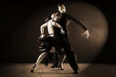 Dancers in ballroom isolated on black background Stock Photos
