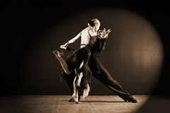 Dancers in ballroom isolated on black background. The dancers in ballroom isolated on black background Stock Photo