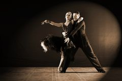 Dancers in ballroom isolated on black background. The dancers in ballroom isolated on black background Stock Photos
