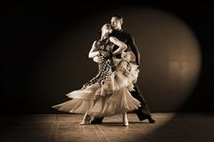 Dancers in ballroom isolated on black background. The dancers in ballroom isolated on black background Stock Photography