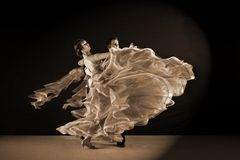 Dancers in ballroom isolated on black background. Latino dancers in ballroom isolated on black background Stock Photo