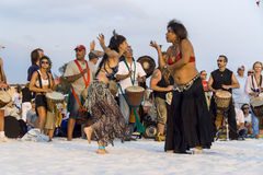 Dancers at beach drum circle. 2 women dance in front of drummers at drum circle Royalty Free Stock Images