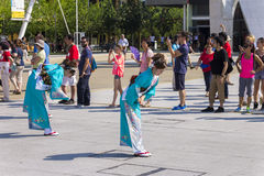 Dancers in blue dresses on the Japanese traditional parade on EXPO 2015 Stock Images