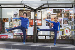 Dancers in a bus shelter. AURILLAC, FRANCE- AUGUST 19: Aurillac International Street Theater Festival,Cie P2BYM, a couple is dancing in a bus shelter, on August stock image