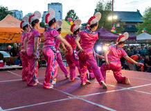 Dancers at chinatown night market Stock Image