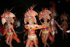 Dancers in costumes at the Grand Carnival Parade Stock Photo