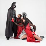 Dancers in costumes and masks Stock Photos