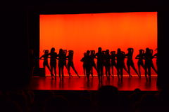 Dancers. A dance team about to perform with a red background Stock Photos