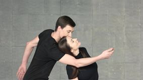 Dancers dancing sensual dance indoor. Young graceful couple of dancers performing dance element. Sensuality and passion stock video