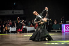 Dancers dancing standard dance. Wroclaw, Poland - May 14, 2016: An unidentified dance couple in dance pose during World Dance Sport Federation European royalty free stock images