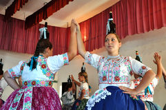 Dancers dancing in traditional Slovak costumes Stock Photos