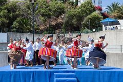 Dancers demonstrating a folk dance at the beach of Funchal, Madeira Island Royalty Free Stock Image