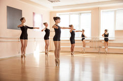 Dancers is doing exercises in ballet class Stock Image