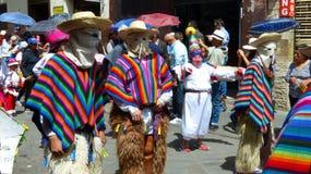 Dancers in ecuadorian traditional dresses and masks. Cuenca, Ecuador stock images