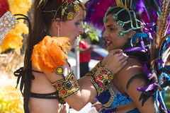 Dancers fix costumes at  Edmonton's Cariwest festival Royalty Free Stock Photo
