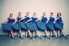Dancers in kilts Stock Photos