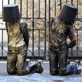 Dancers are kneeling, a bucket on the head. Stock Image
