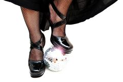 Dancers legs with disco ball Stock Photo
