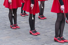 Dancers legs girls. Beautiful legs dancing girls in the street Stock Photography