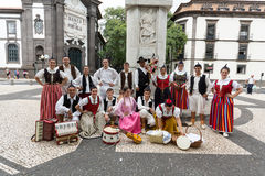 Dancers with local costumes demonstrating a folk dance during the Wine Festival in Funchal on the Madeira Royalty Free Stock Photo