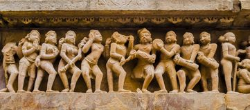 Dancers and musicians in erotic scenes, Kahjuraho temple, India stock image